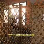 Cortina e decoração com bambu.